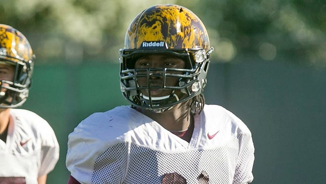 ASU defensive lineman George Lea works out during ASU's spring football period in Tempe on April 7, 2015.