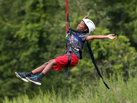 10-year-old Ryan Williams of Mt Olive zip lining during