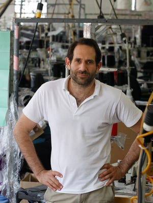 Dov Charney, founder of American Apparel, is photographed at the company's factory in downtown Los Angeles in April 2012.