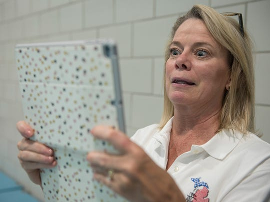 Maureen Kelly, of Beverly Hills, views video of a practice routine. She also is the team cook.