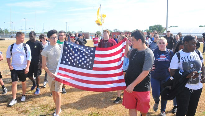 About 75 students walked out of Rockledge High School at 10:30 a.m. on Friday and onto the athletic field in support of the 2nd Amendment.