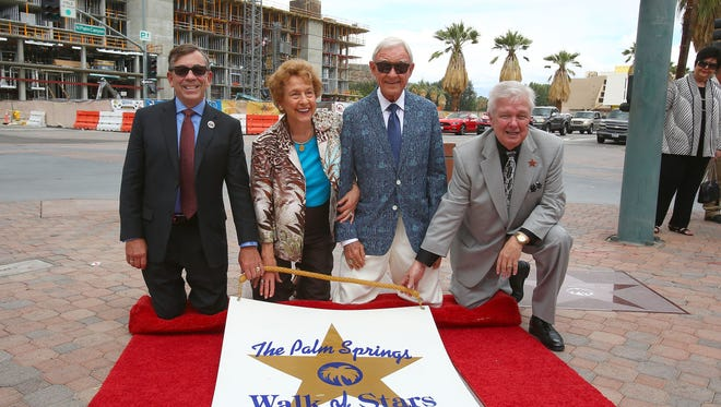 Richard and Janice Oliphant, center, receive their star on the Palm Springs Walk of Stars, May 6, 2016.  At left is Palm Springs mayor Robert Moon and at right is Walk of Stars chariman Bob Alexander