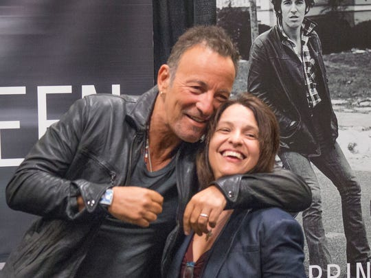Bruce Springsteen and a fan at the Banes and Noble in Freehold Twp. in 2016.