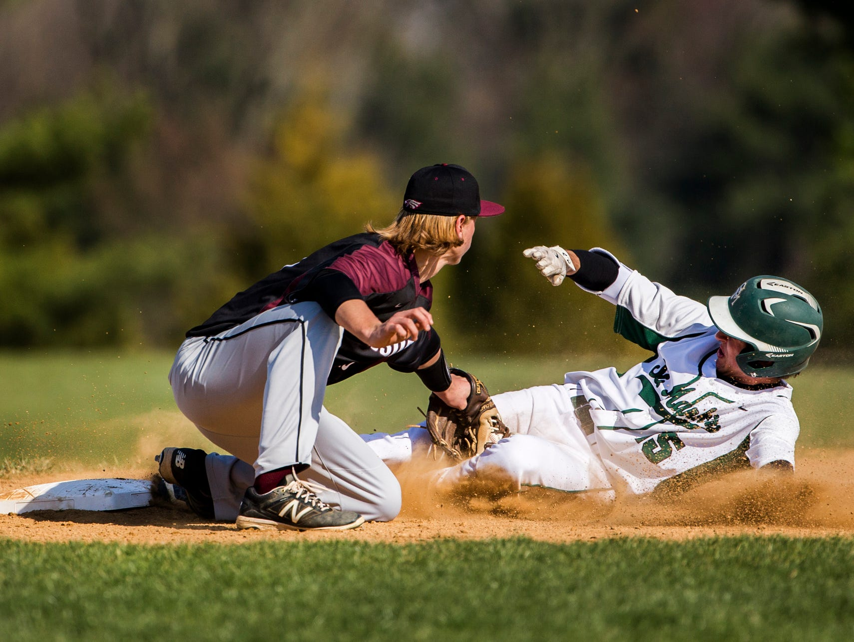 Hodgson's Jonathan Megginson tags St. Mark's Matthew Theodorakis out at third base in St. Mark's 12-0 win over Hodgson at St. Mark's High School on Wednesday afternoon.