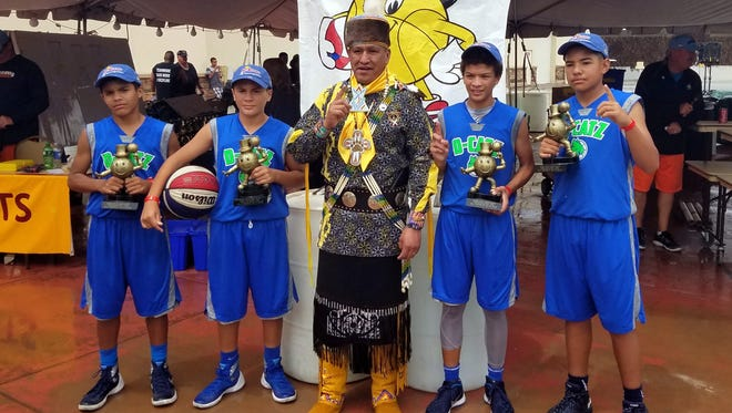 Deming ballers wound up in the Gus Macker 3-on-3 tournament in Mescalero this past weekend.  They won the 13-14 age division championship, making it two tournament titles this summer. The team previously captured a championship in Las Cruces. The team posted a 7-1 record en route to the title. Pictured, from left, are Jordan Caballero, Jonathan Caballero, an unidentified man, Nathan Arroyos and Christian Pacheco.