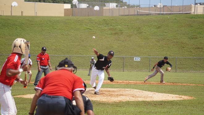 The Simon Sanchez Sharks beat the Okkodo High Bulldogs 6-4 in an Independent Interscholastic Athletic Association of Guam Baseball League game at Okkodo High School on Saturday, Oct. 31, 2015.