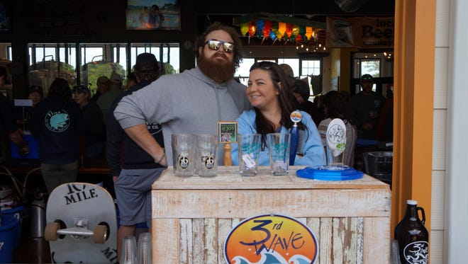 Ben Jones of 16 Mile Brewery and Tracy Huggans of 3rd Wave Brewery working together to promote their respective companies.