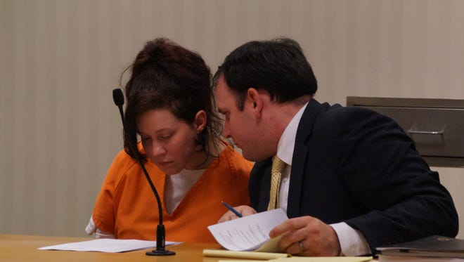 Tina M. Hafeman confers with her attorney, Michael D. Petersen at her initial appearance in Outagamie County Circuit Court on Tuesday, May 31, 2016.