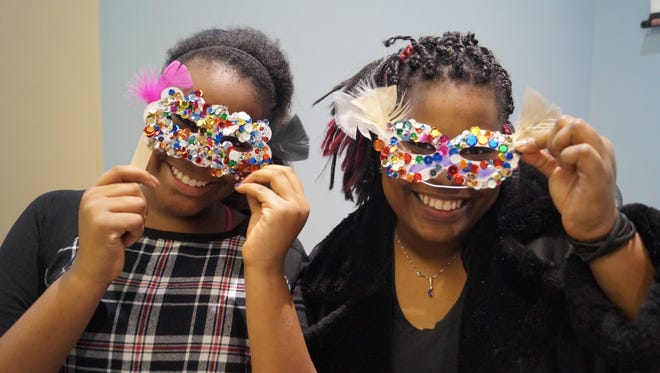 Kyndra Straughter and her mother, Kimberly Straughter, enjoyed creating their very own make and take party masks as part of the New Year's Eve festivities.