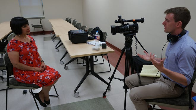 Blanca Araujo, an associate professor in the College of Education's School of Teacher Preparation, Administration and Leadership, speaks with a reporter from C-SPAN about a book she co-authored regarding research on border-crossing students.
