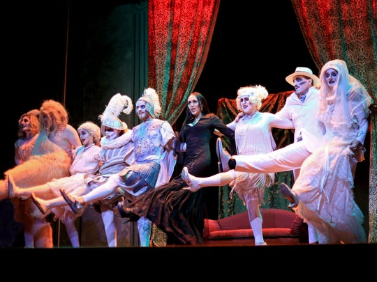 """Paige Allred, fourth from right, plays Morticia Addams in The Stage Door's production of """"The Addams Family"""" musical at the Electric Theater in St. George."""