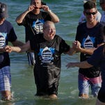 Members of the Hillcrest Baptist Church gathered west of the the Pensacola Beach Gulf Pier late Sunday afternoon for their annual Baptism Celebration.  Approximately 30 people were baptized in the gulf making it a total of about 80 baptisms for the day at the different campuses of the Hillcrest Baptist Church.