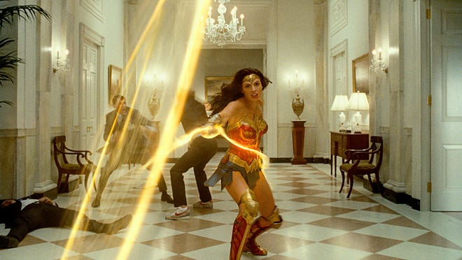 Wonder Woman (Gal Gadot) practices some ropin' in a White House corridor.
