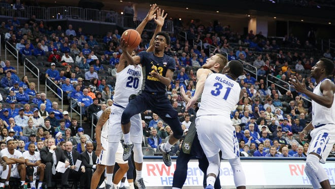 Marquette guard Jajuan Johnson  drives to the basket during the Golden Eagles' 69-66 loss to Seton Hall on Jan. 1 at the Prudential Center. Marquette is looking to bounce back after losing two straight when the Pirates visit the BMO Harris Bradley Center on Wednesday.
