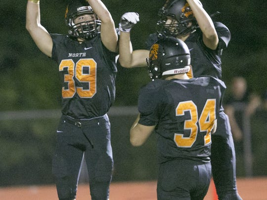 HS Football Howell at Middletown North. North's WR Marc Cerbo #39 celebrates with team members after catching a pass for North's 3rd TD —September 23, 2016-Middletown, NJ.-Staff photographer/Bob Bielk/Asbury Park Press