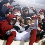 Oklahoma receiver Sterling Shepard celebrates with fans after beating Oklahoma State. The Sooners look locked into the College Football Playoffs.