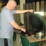Mitch Perry grilling on his Big Green Egg for friends and family get-together.