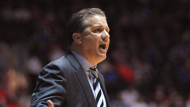 Kentucky coach John Calipari gestures during his team's NCAA college basketball game against Mississippi in Oxford, Miss., on Tuesday, Feb. 18, 2014. (AP Photo/Oxford Eagle, Bruce Newman) MAGS OUT  NO SALES  MANDATORY CREDIT