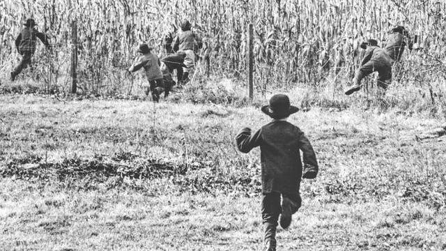 The three-year old dispute between Iowa's public-school officials and the Old Order Amish community of Hazleton, Ia., became a subject of national interest with the reprinting all over the country of Thomas DeFeo's photograph, first published in the Des Moines Register and Tribune on November 20, 1965. The picture showed Amish children, with their sideburns and black hats, scurrying for cover in the cornfields to escape the pursuing public-school truancy officer. For religious reasons the Amish did not permit their children to attend public schools; instead, they maintained their own private schools.