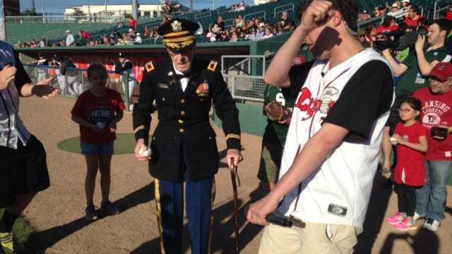 Gilbert Holmes, 97, of Holt, was honored Friday at Cooley Law School Stadium for his nealry 40 years of military service. Holmes served in WWII and the Korean and Vietnam wars.
