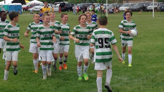 Happy members of the Canton Celtic '04 White boys soccer team congratulate each other after winning Sunday's championship game in their bracket at Heritage Park.