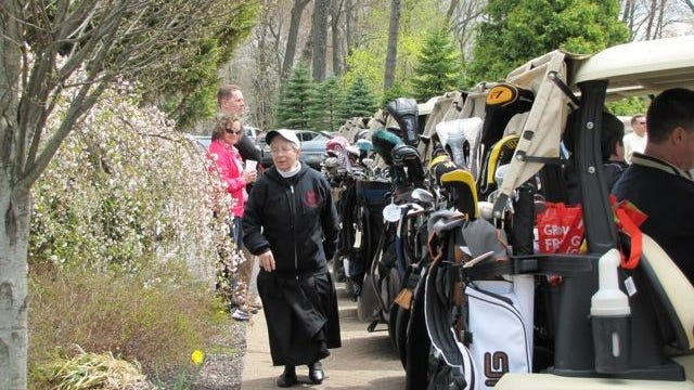 Sister Pamela heads to the greens before the start of the Nun Better Golf Outing.