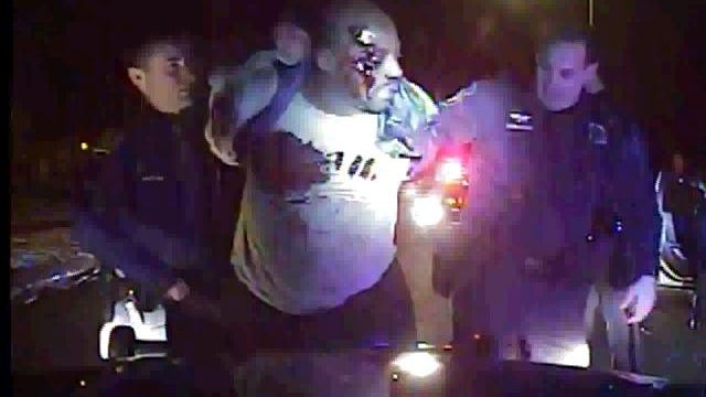 Frame grab from patrol car video shows Inkster police pulling Floyd Dent from his car then beating and Tasering him during a traffic stop.
