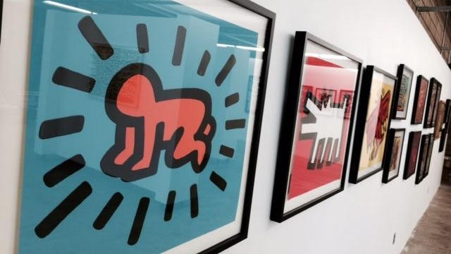 "The success of the first ""Urban Visionaries"" show in 2014 at the Des Moines Social Club prompted both a repeat exhibition this year and a broader slate of events called Art Week. Shown here is a series of prints by the late Keith Haring."