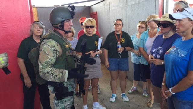 Maj. Todd Holland talks to a group of participants following a brief live fire exercise at the Brevard County Sheriff's Office Citizen's Academy in Cocoa on Saturday.