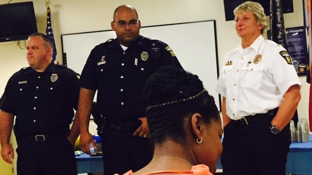 At left, Mansfield police Sgt. Stephen Blust, and Sgt. Tonelli Webb wait for their promotion to sergeant ceremony to commence. Capt. Shari Robertson is at right and in the forefront is Tonelli's wife Tamiko.