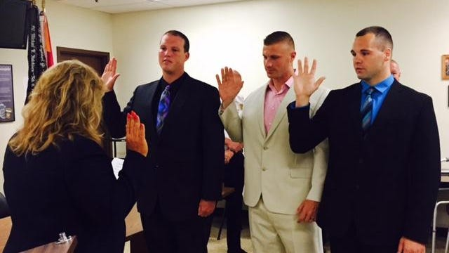 Freeman Nixon, in beige suit, was one of three new Mansfield police officers sworn in by Safety-Service Director Lori Cope on July 28, 215. Also taking the oath were  Nolan A. Goodman, left, and Heath Underwood.