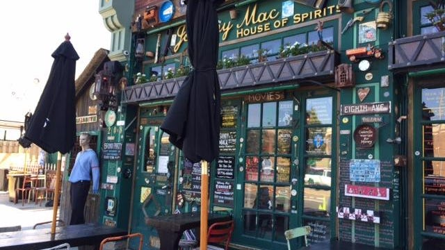 Pictured is the facade of Johnny Mac on Main Street in Asbury Park. The city is demanding that the bar remove all of its exterior decorations.