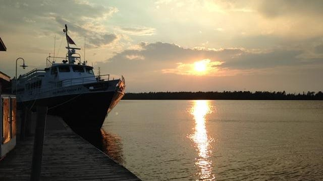 The Isle Royale Queen at the dock at sunset in Copper Harbor.