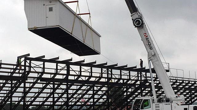 A large crane was used to install a new press box at Fairfield High School's stadium, now undergoing renovations.