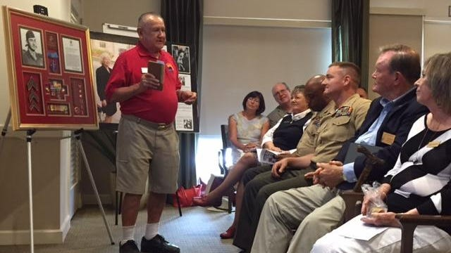 Palm Springs Air Museum historian Bob Andrade talks about the aerial feats of U.S. Marine Corps Brig. Gen. Fritz Payne at Atria Hacienda in Palm Desert on Friday, Aug. 14, 2015. Andrade is holding a flight log belonging to Payne, who, until his recent death, was the country's oldest living fighter ace.