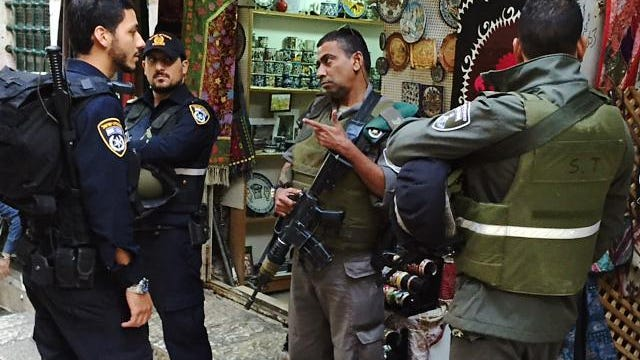 Police officers, left, and border officers are a common sight in the Old City section of Jerusalem as part of increased security effort.