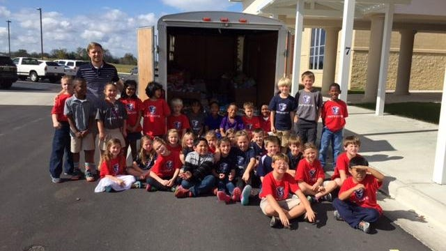 Pike Road School students and teachers are shown with the Adullam House truck after loading their donations.