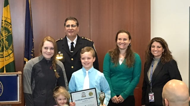 Evan Bovee shows off his trophy and certificate at the Rochester Police Department's Do the Right Thing Awards Ceremony. provided photo