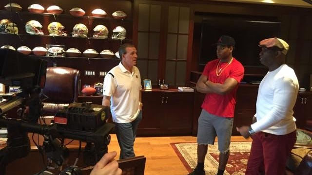 Deion Sanders and Jalen Ramsey talk with FSU coach Jimbo Fisher in his office Wednesday.