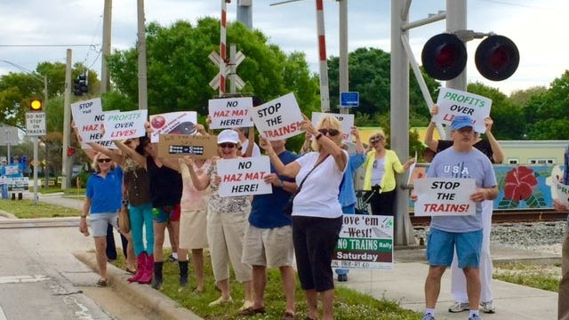 Protesters rally March 19 against the proposed All Aboard Florida passenger rail project at the eastbound crossing on Route 60 in Vero Beach. (CONTRIBUTED PHOTO)