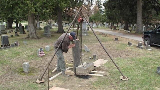 "Jim ""Woody"" Jim ""Woody"" Woodman working on the Carlin gravestone in Burlington's Lakeview Cemetery."