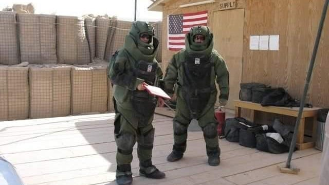 EOD technician Maj. Jeff Hackett, right, on deployment. Although he saved many lives, Hackett had issues dealing with the deaths of 16 colleagues and committed suicide in June 2010.