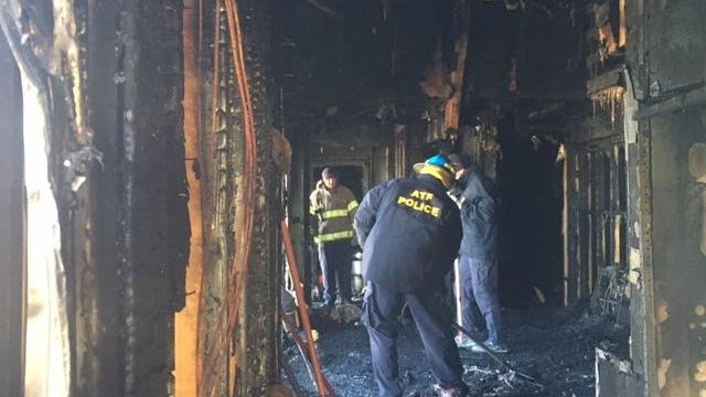 Agents from the federal Bureau of Alcohol, Tobacco, Firearms and Explosives investigate a fire at a mosque in Pittsfield Township.