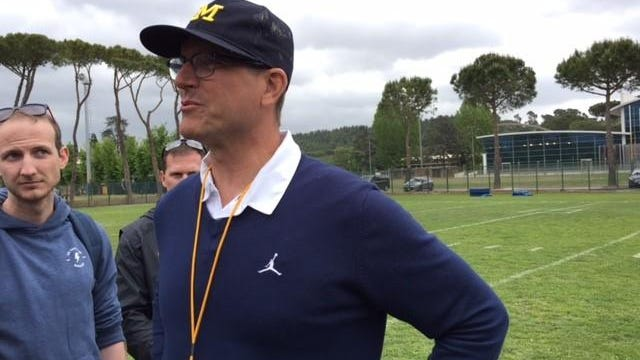Michigan coach Jim Harbaugh on Saturday said he felt he, his staff and team were innovators and pioneers and plans to take his team abroad next year.
