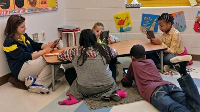 Third grade teacher Madison O'Hara and her students use iPads at John McIntire Elementary School.