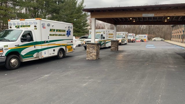 Ambulances line up outside the New Windsor Country Inn adult home on Wednesday. Several residents with coronavirus symptoms have been taken to the hospital.