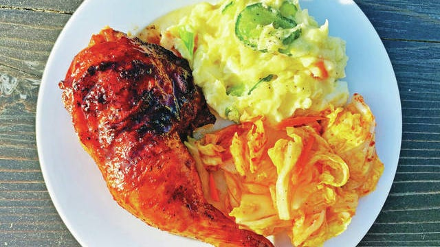 Gochujang-glazed grilled chicken with potato salad and kimchi. Photo by Genevieve Ko/Los Angeles Times/TNS