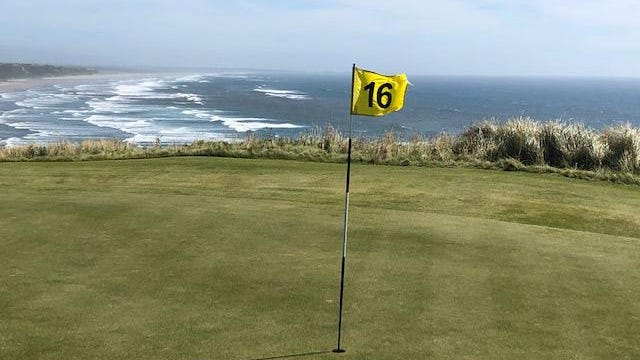 The 16th green is one of several with sweeping views of the Pacific Ocean at Sheep Ranch, the newest course at Bandon Dunes Golf Resort.