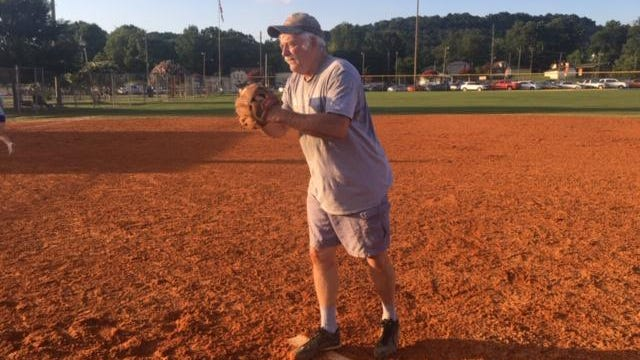 72 year old Danny Coffelt, a retired fire captain from Hokes Bluff, pitches for the Highland Church softball team.