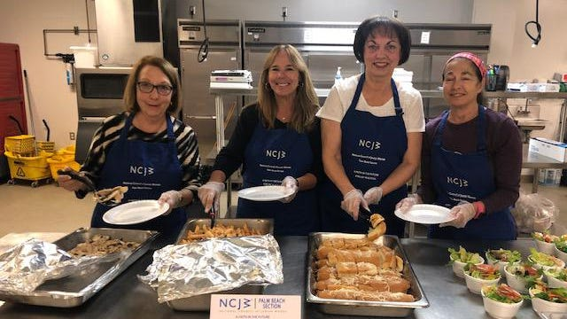 National Council of Jewish Women volunteers serve dinner to residents at The Senator Philip D. Lewis Center in West Palm Beach recently as part of its Meals for a Cause program.